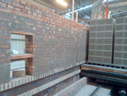 Construction of the new kiln entrance, without stopping production.